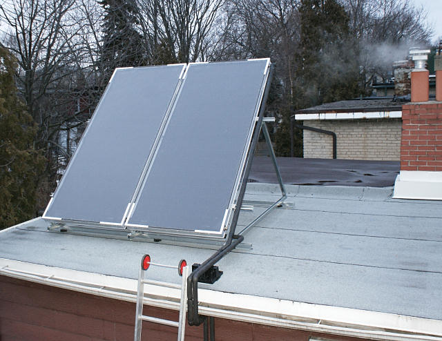 More flat plate solar panels on a Toronto roof